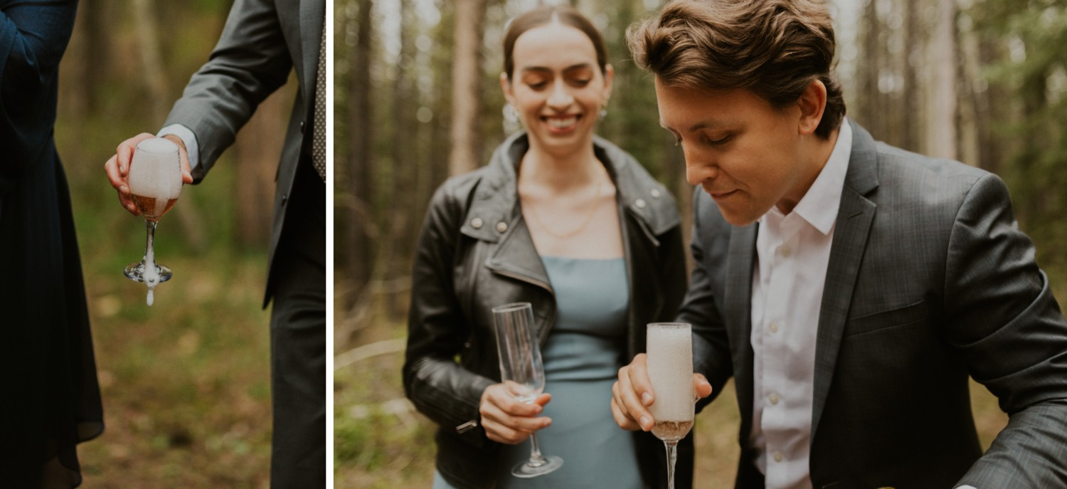A Kananaskis Lake Elopement in the beautiful Canadian Rockies photo of outdoor reception in the forest with toasts and laughs