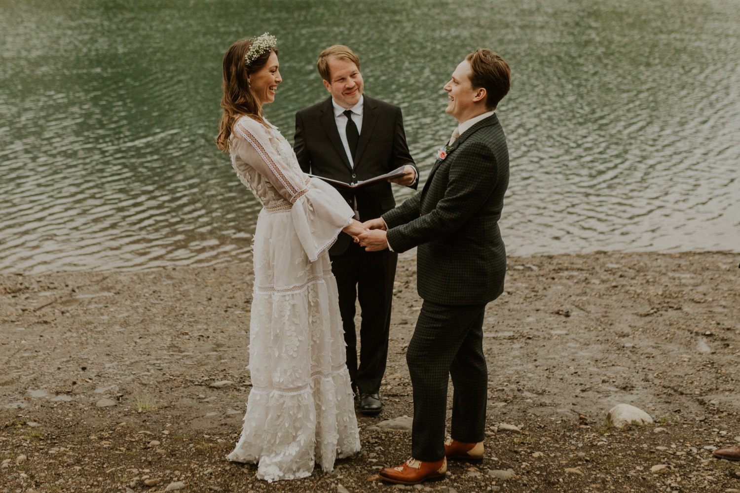 A Kananaskis Lake Elopement in the beautiful Canadian Rockies emotional photo of vows during ceremony