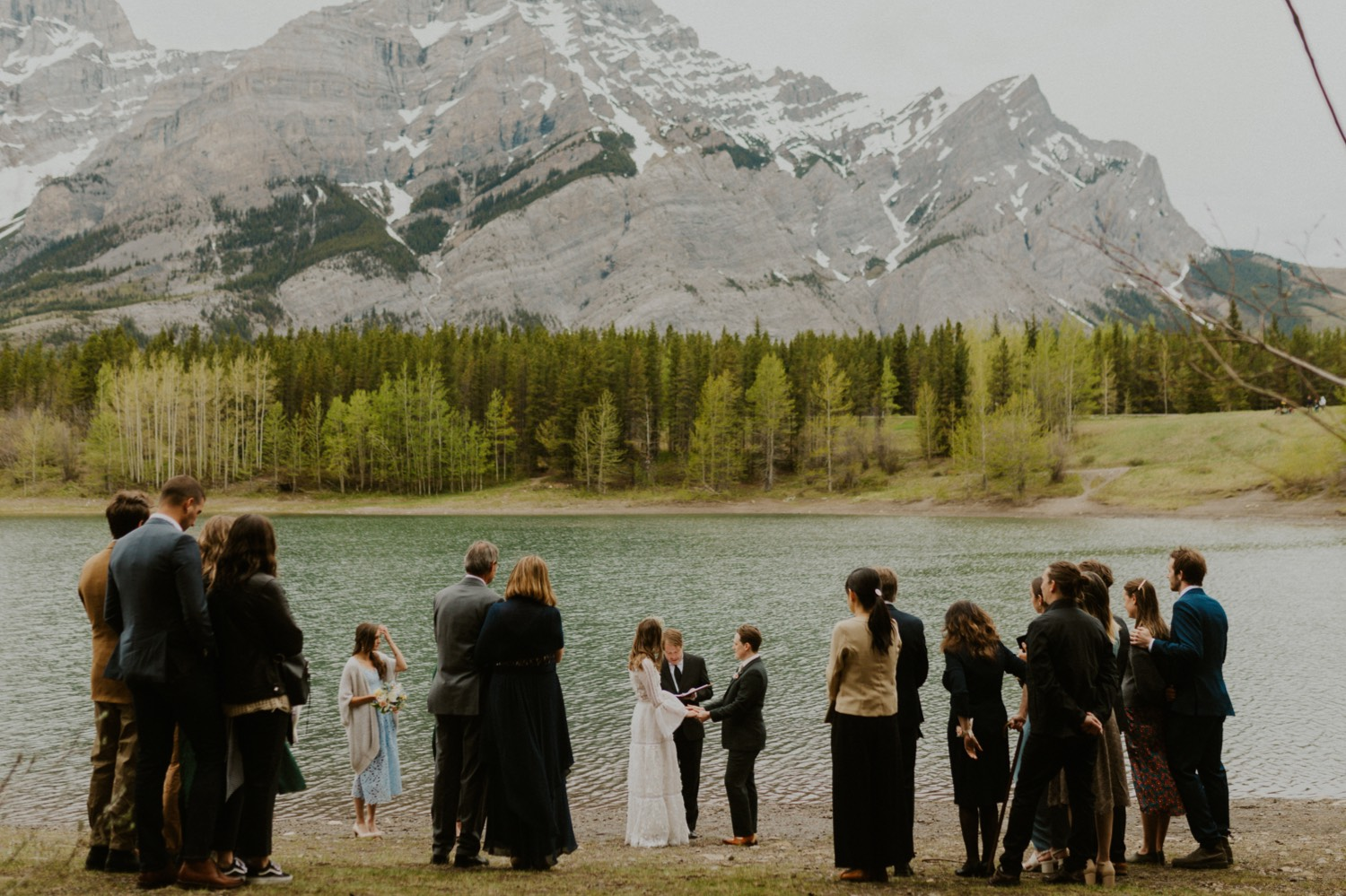 A Kananaskis Lake Elopement in the beautiful Canadian Rockies photo of ceremony in front of the lake