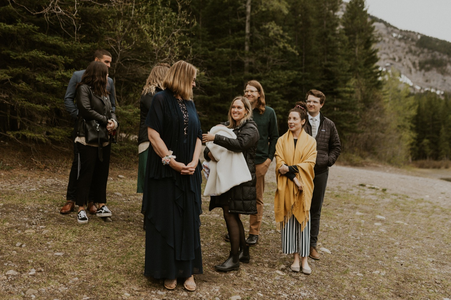 A Kananaskis Lake Elopement in the beautiful Canadian Rockies photo of family walking to ceremony spot
