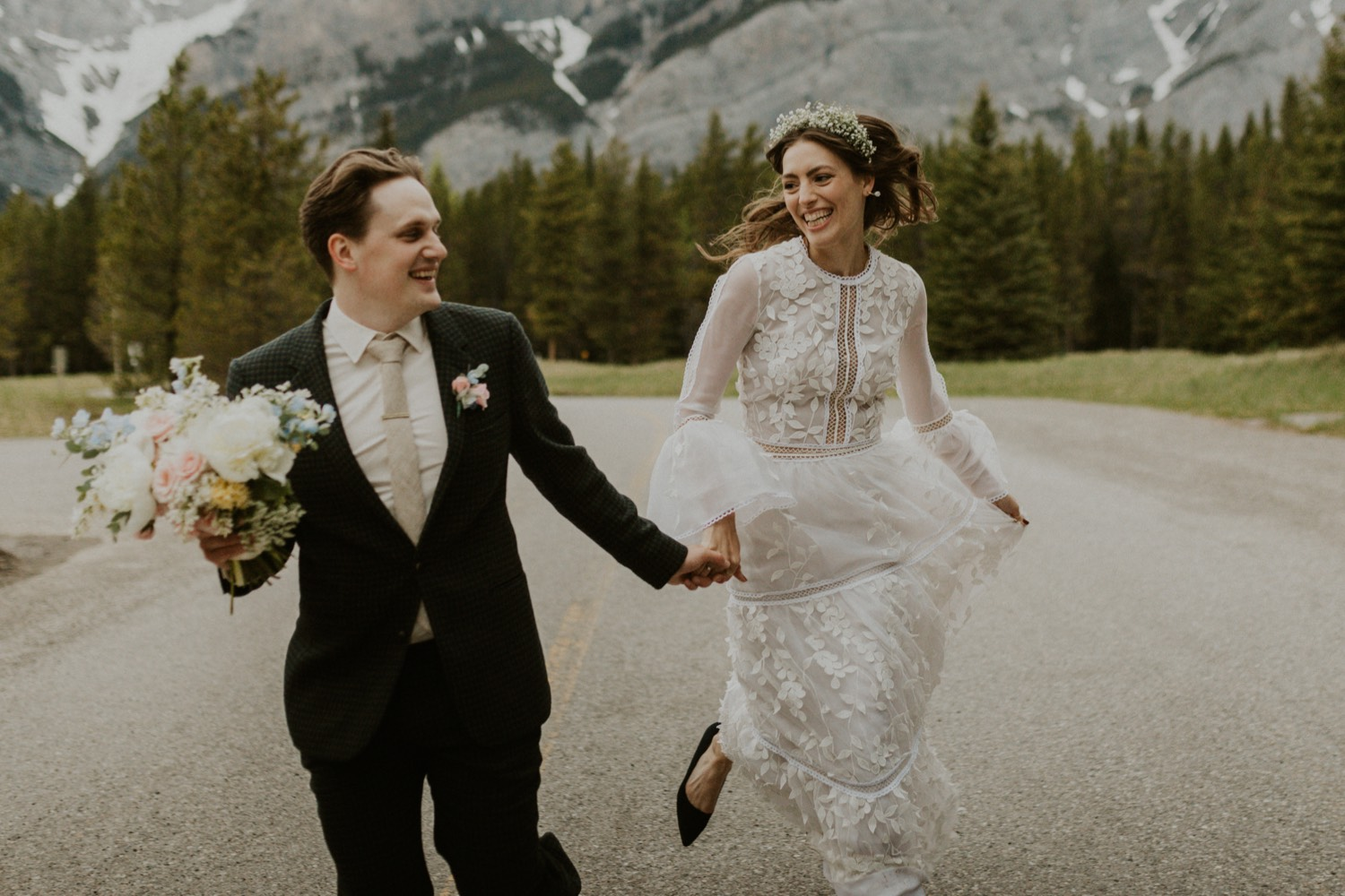 A Kananaskis Lake Elopement in the beautiful Canadian Rockies photo of bride and groom portraits