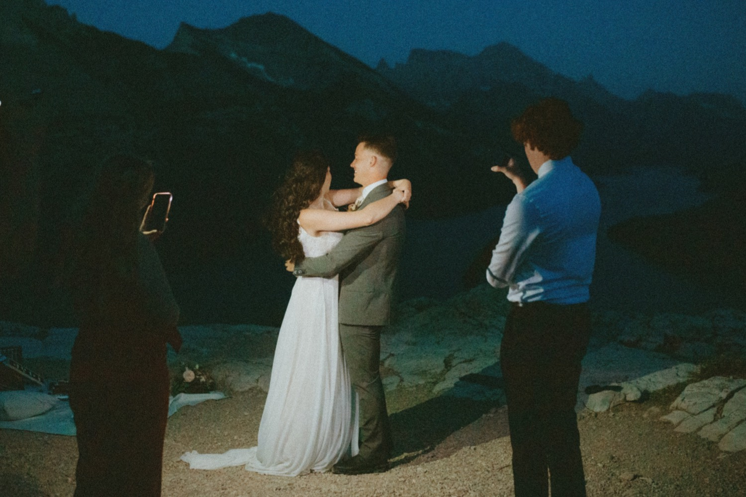 Waterton Wedding Adventurous Mountain Elopement style in the beautiful Canadian Rocky Mountains picture of couples first dance under the stars right after their elopement ceremony on a mountain top