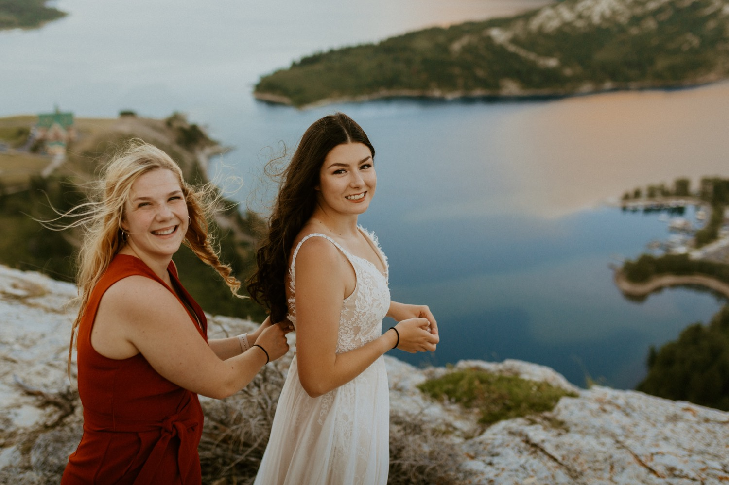 Waterton Wedding Adventurous Mountain Elopement style in the beautiful Canadian Rocky Mountains bride putting on her boho dress on a mountain top