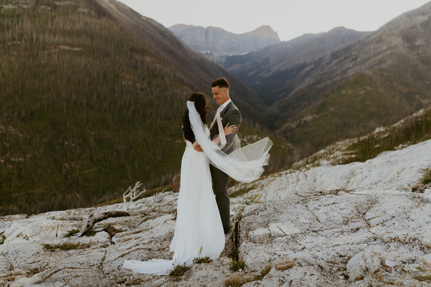 Waterton Wedding Adventurous Mountain Elopement style in the beautiful Canadian Rocky Mountains first look between bride and groom on the mountain top