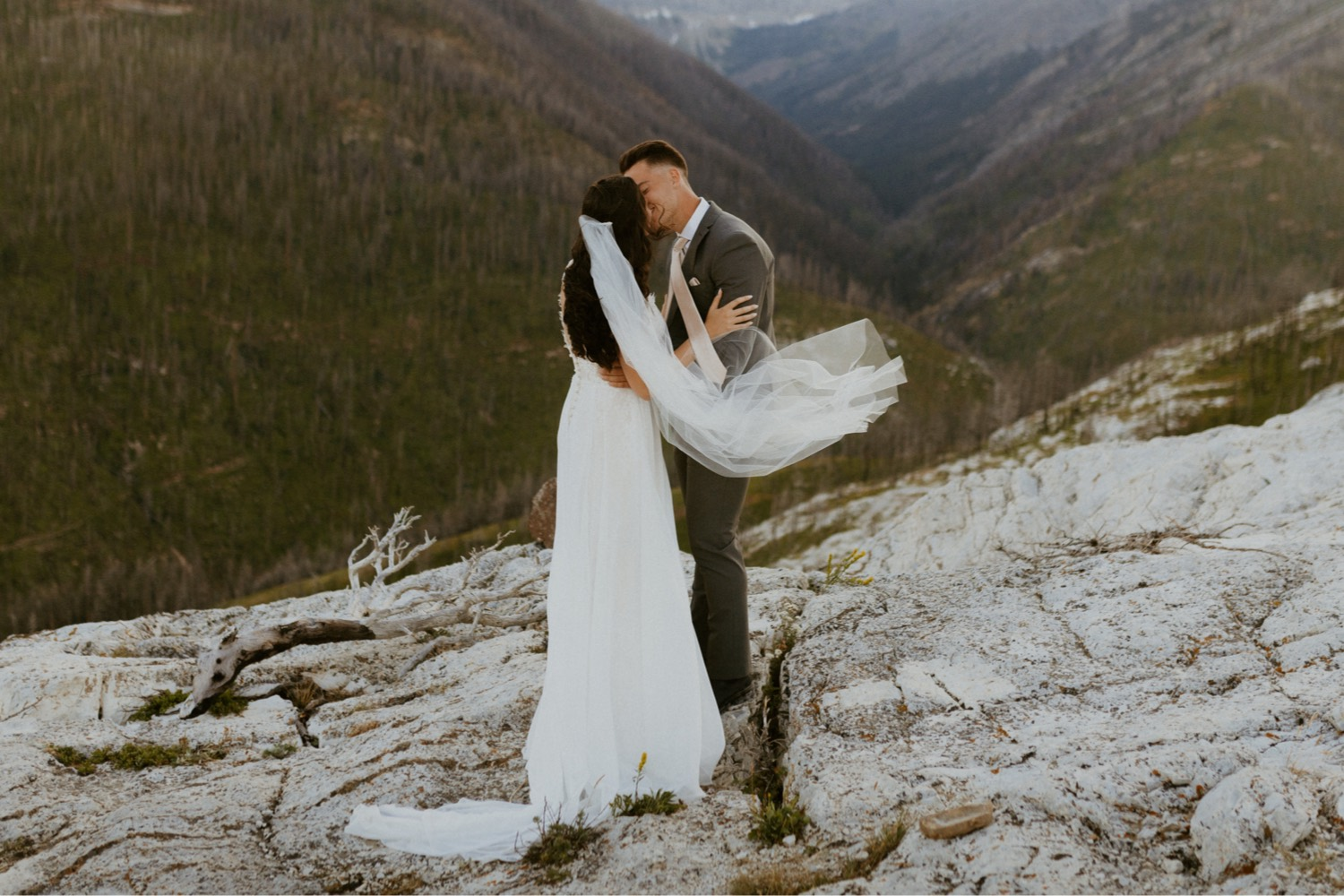 Waterton Wedding Adventurous Mountain Elopement style in the beautiful Canadian Rocky Mountains first look between bride and groom on the mountain top with personalized letters to each other
