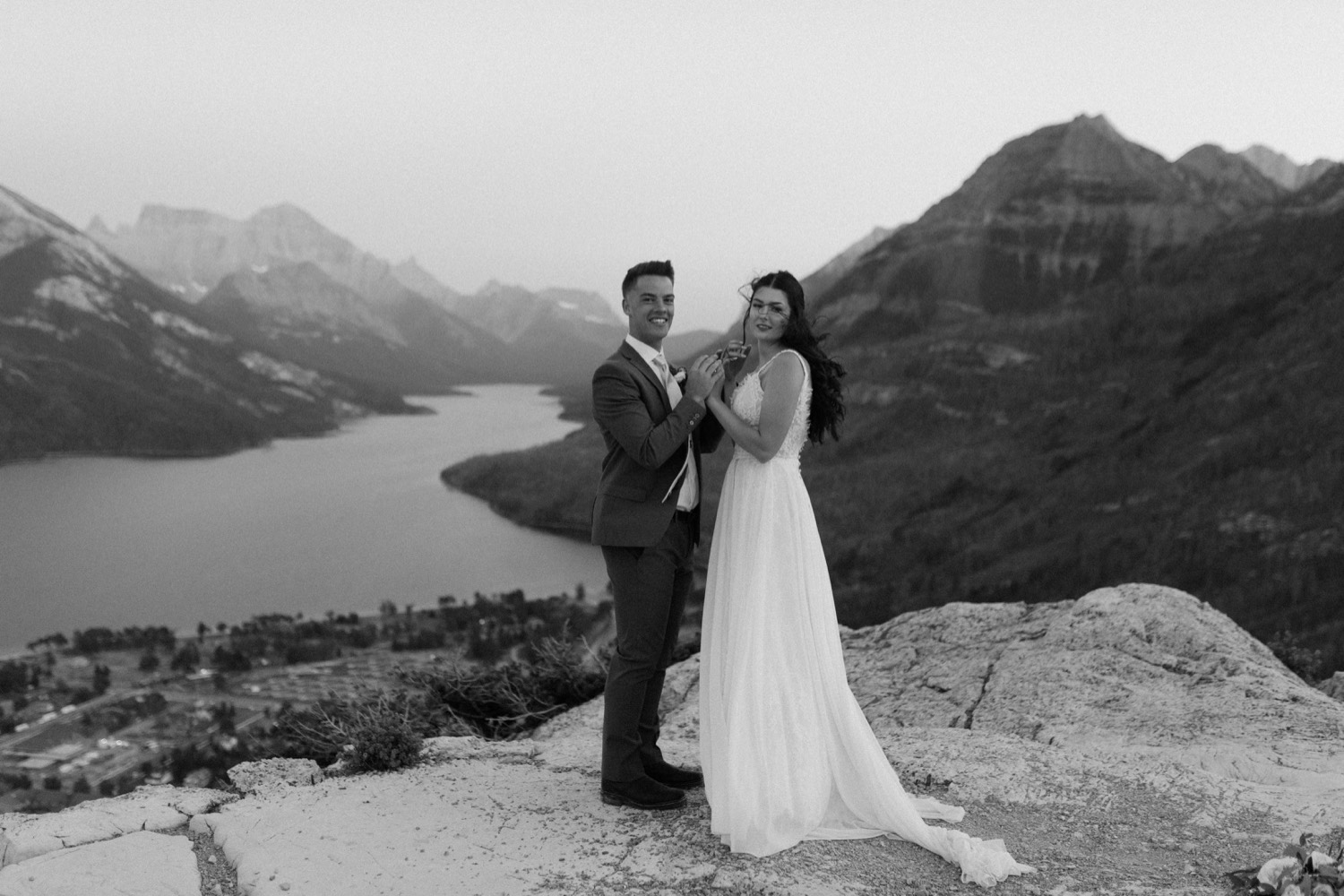 Waterton Wedding Adventurous Mountain Elopement style in the beautiful Canadian Rocky Mountains couple photos of couple on the mountain top right after their ceremony with close friends and officiant