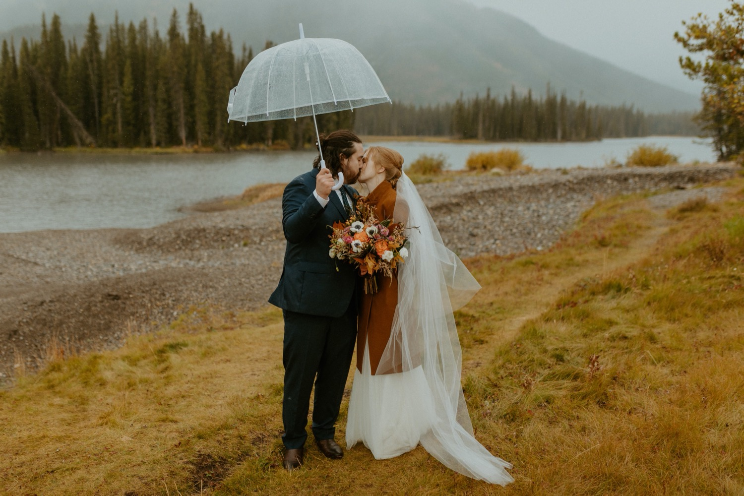 Banff Elopement, Banff Elopement with Family present, Small wedding in Banff, Banff small outdoor wedding, Banff small wedding with friends and family present, how to elope with family present, family elopement, Banff summer elopement, Banff fall wedding, Ceremony in Canmore, Wedding Ceremony at Sprays Lake in Canmore, How to get married in Banff, How to get married in canmore, Banff wedding photographer, Banff Elopement Photographer, Wedding near Banff in Canmore